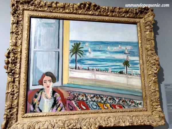 Mujer sentada, de espaldas a la ventana abierta - Matisse